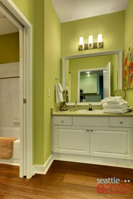 Unwind after a long day or get ready for the night in the crisp and clean bathroom.