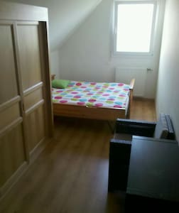Chambre 2 lits simples. - Huis
