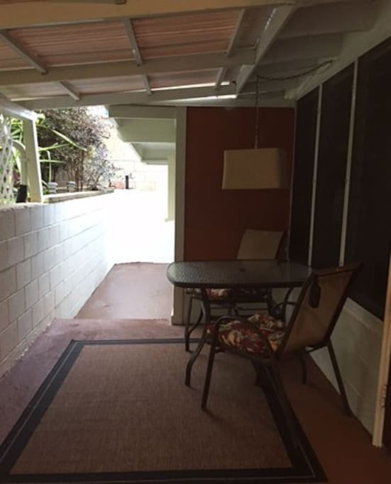 Extended covered lanai with a full size table.