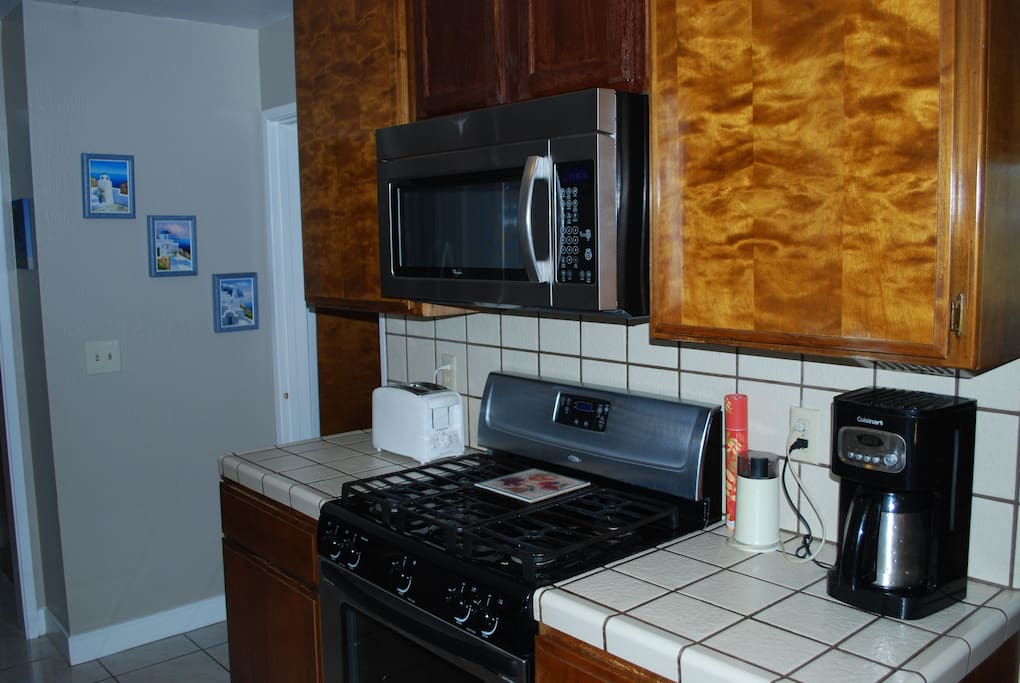 This is our kitchen with a gas range and cooktop.