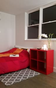 A perfect night's rest in a cool, quiet neighborhood - a 10 min train ride from Manhattan.  Our clean & cozy apartment gets loads of sunlight, filling the place with bright, good energy. It is minimally and tastefully decorated for a zen-like feel.