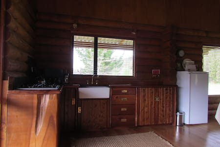 Triple Tui self contained Log Cabin - Cabanya