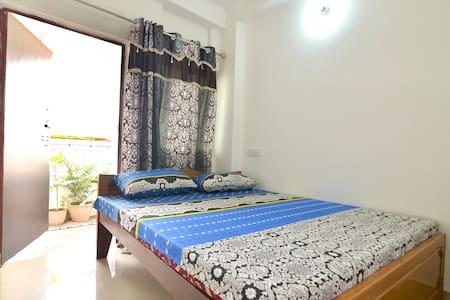 Ganga GH + Music School ( Deluxe A/C double bed ) - Varanasi