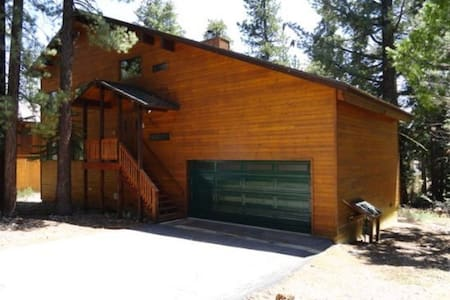 This mountain home has four bedrooms and three bathrooms. Easily sleeps 12+ and has plenty of room for the entire family! As you enter the home, you immediately feel the abundance of space. The family room is large and comes with a card table.