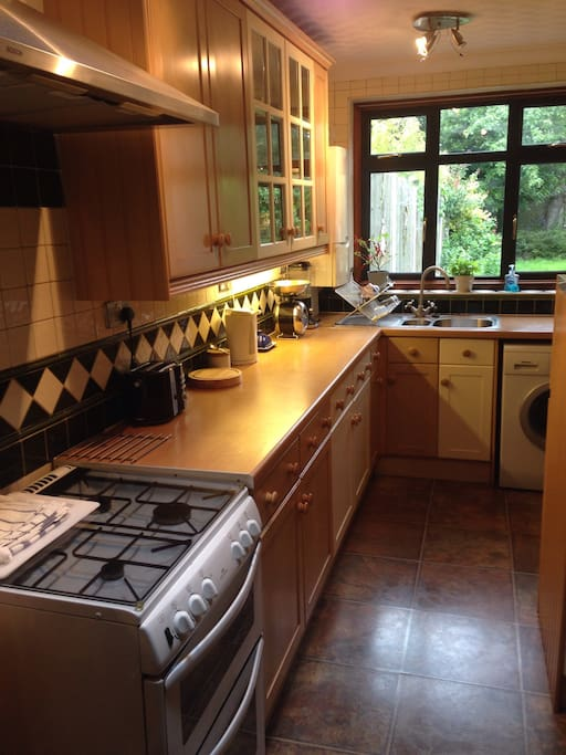 Fully equipped Kitchen. Gas oven. Washing machine with fast wash cycle. Adjacent to Breakfast room and door to patio.