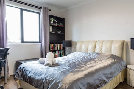 sunny room with genuine Leather queen bed - Keysborough