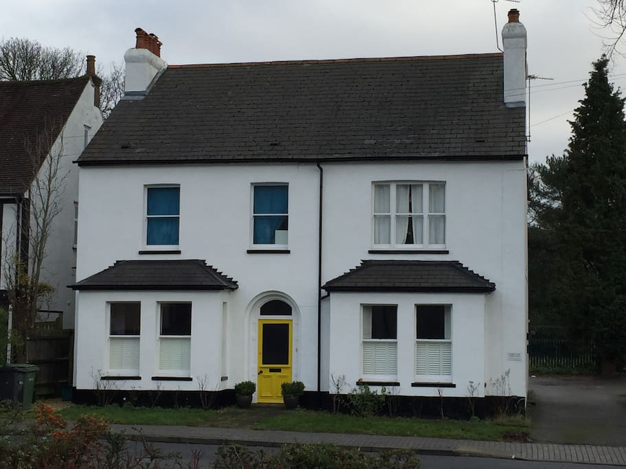 Only flat accessed by yellow front door. Left hand ground-floor windows belong to private room.