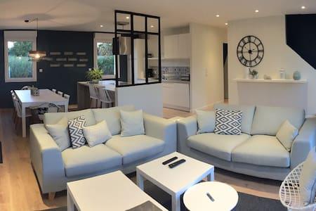 Maison spacieuse et confortable - Huis