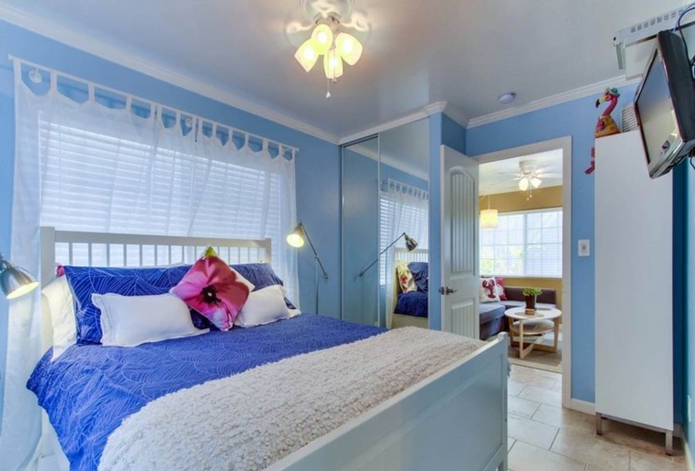 Bedroom has queen-size bed, ceiling fan, lots of storage and TV with Cable channels.