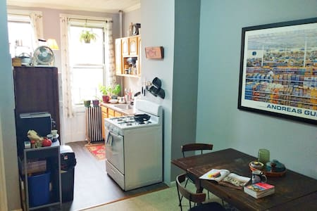 Bright home with artisan furnishings on a quiet block near Bushwick. Comfy memory foam queen mattress sleeper sofa in the central room of a Railroad apartment. Close to bars, shops & restaurants, near transportation, a 20 minute ride into the city.