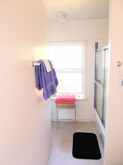 Primary bedroom's private bath  has tub and shower.  Enter from master bedroom or off the kitchenette