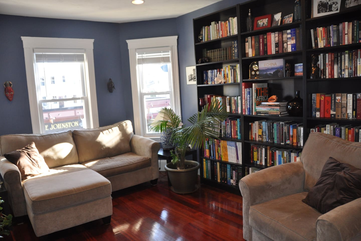 Living room with large library of books to peruse