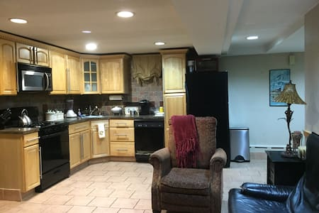 One bedroom apartment in a private house.  Fully renovated open kitchen/small breakfast area & large living space. Kitchen has all appliances. Bedroom has full size bed (2 ppl) and there's a pull out bed in the living room if needed. Perfect location
