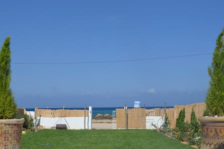 Charmante maison sur la plage - Haus