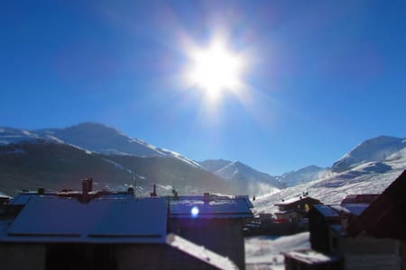 The apartment has two floors and has an indipendent entry. In the apartment  there are two bathrooms and two bedrooms. It's located in a quiete zone but in a few it's possible reach the centre of Livigno.