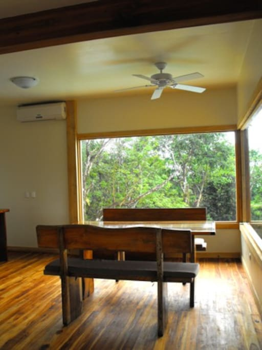 main floor dining room, panoramic windows to ocean view