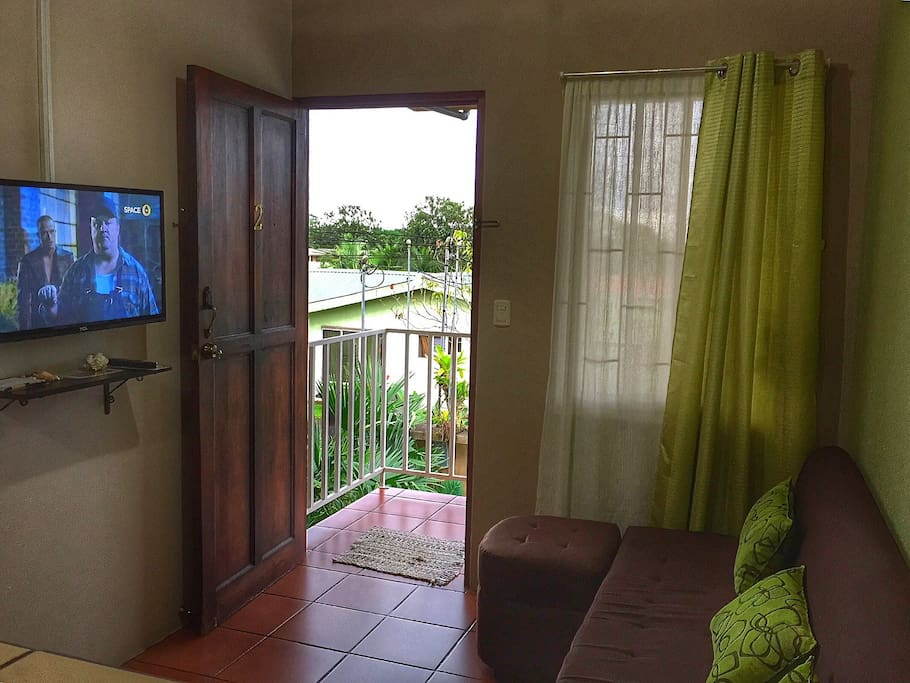 "Spacious fully furnished kitchen (appliances and cooking ware) with bar top connected to the cozy living room equipped with a comfortable couch, 32"" plasma TV and cable. Wifi available throughout the apartment."