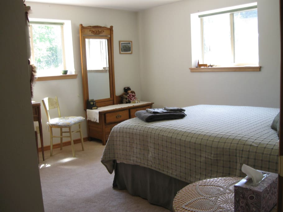 Queen bedroom with mountain view and creek lullaby