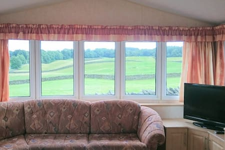 Situated alongside our home in the Lake District National Park, we have a 6 berth static caravan. The caravan itself is modern, clean and well equipped.  The location is an excellent base for the South Lakes (Kendal/Windermere).