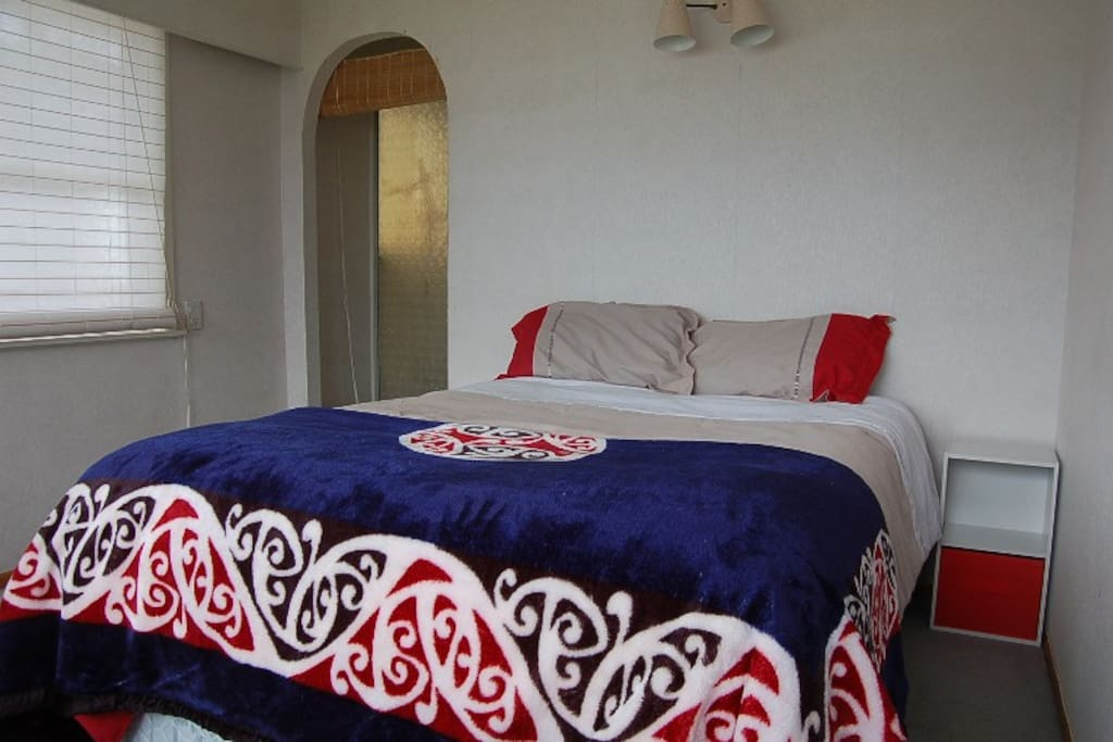 Double bedroom with private bathroom overlooking lake
