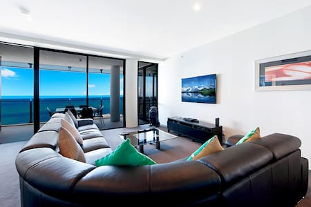 Our equal Largest Circle sub Penthouse is 1462 - 46 Levels above Surfers Paradise.  3 bedrooms, two living areas, 2 bathrooms + 3rd toilet.  Amazing and huge wrap-around balconies, superb Ocean and City views.  Can you beat it? See for yourself.   Free Wi-Fi Free Foxtel Movies channels Free Fox Sports Free Parking for two cars.