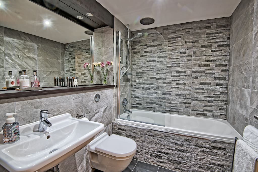 Enjoy a relaxing bath or revive under our rain shower! Enjoy our luxurious toiletries