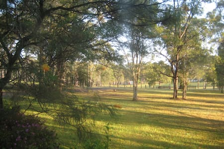 Relax and enjoy lovely view from the QS bed. Rural setting with plenty of birdlife and native animals on the hinterland 5kms from Wauchope and 18kms inland from Port Macquarie beaches! Access to kitchen facilities, main bathroom and in- ground pool.
