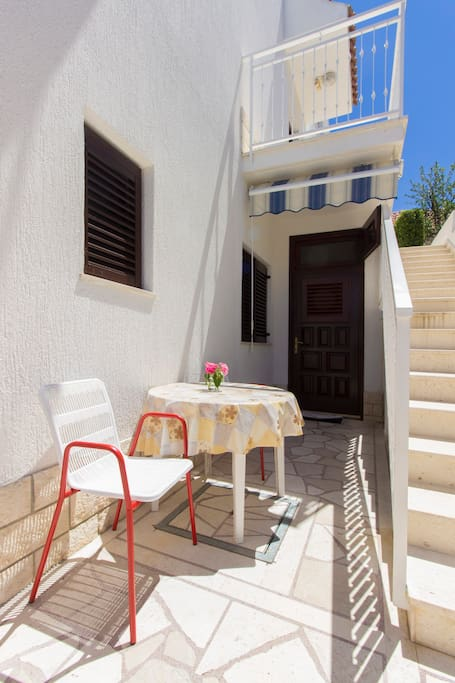 Small terrace has privacy, table with chairs and tent to protect from sun.