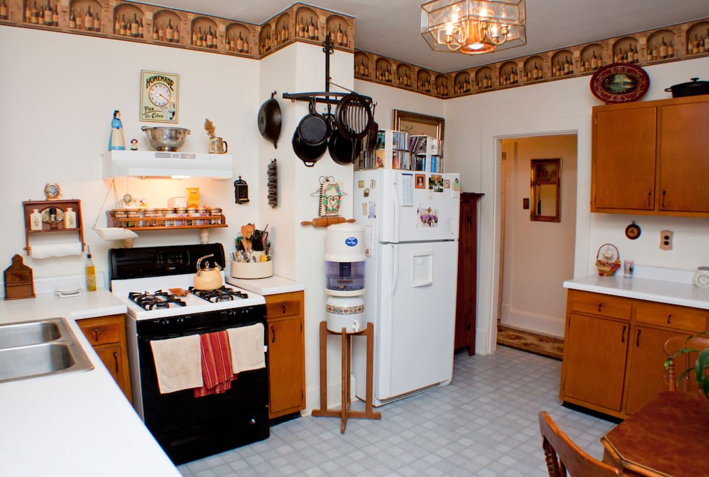 Kitchen with lots of cast iron for cooking .