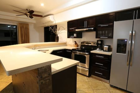Residences 2 & 3 bedroom condos - Apartment