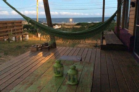 Vista  al mar con estufa a leña - Arachania - Casa