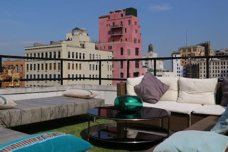 Experience this once in a lifetime West Village penthouse apartment, perched on the top of a neo-classical 19th-century building next to the Hudson River. The penthouse rest in the heart of the West Village and includes your own furnished roof-terrace with views of every major NYC landmark.