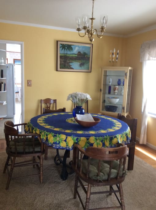Spacious vibrant dining room. Seats up to 6 people. Captures daily natural light