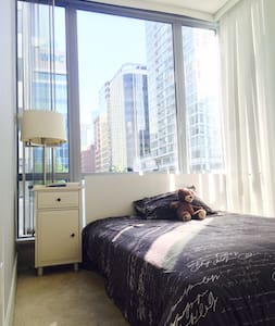 Hello Travelers,  This bedroom is located in one of the best areas of Vancouver; you are only 5 min away from Stanley Park, the Convention Centre, Canada place and only two blocks away from the famous Robson street.  The apartment has stunning views to West Vancouver,Stanley Park  and the Ocean. The building has access to GYM facilities, Hot tub and also grocery shopping right in front of the building.