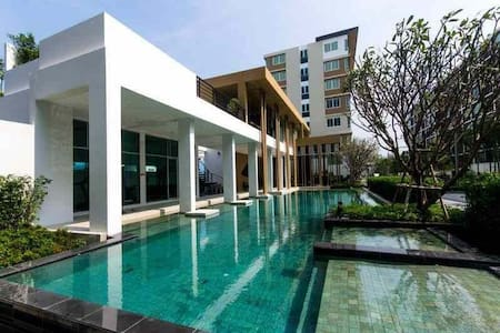 A new apartment ( condo ) at prime location ( huahin (phone number hidden) minutes to the beach and near to  market, shopping mall, hua hin bus & train station. Inside room including full-furnish and special offer with internet wifi, pay TV ( True vision). Beautiful swimming pool and good gym.