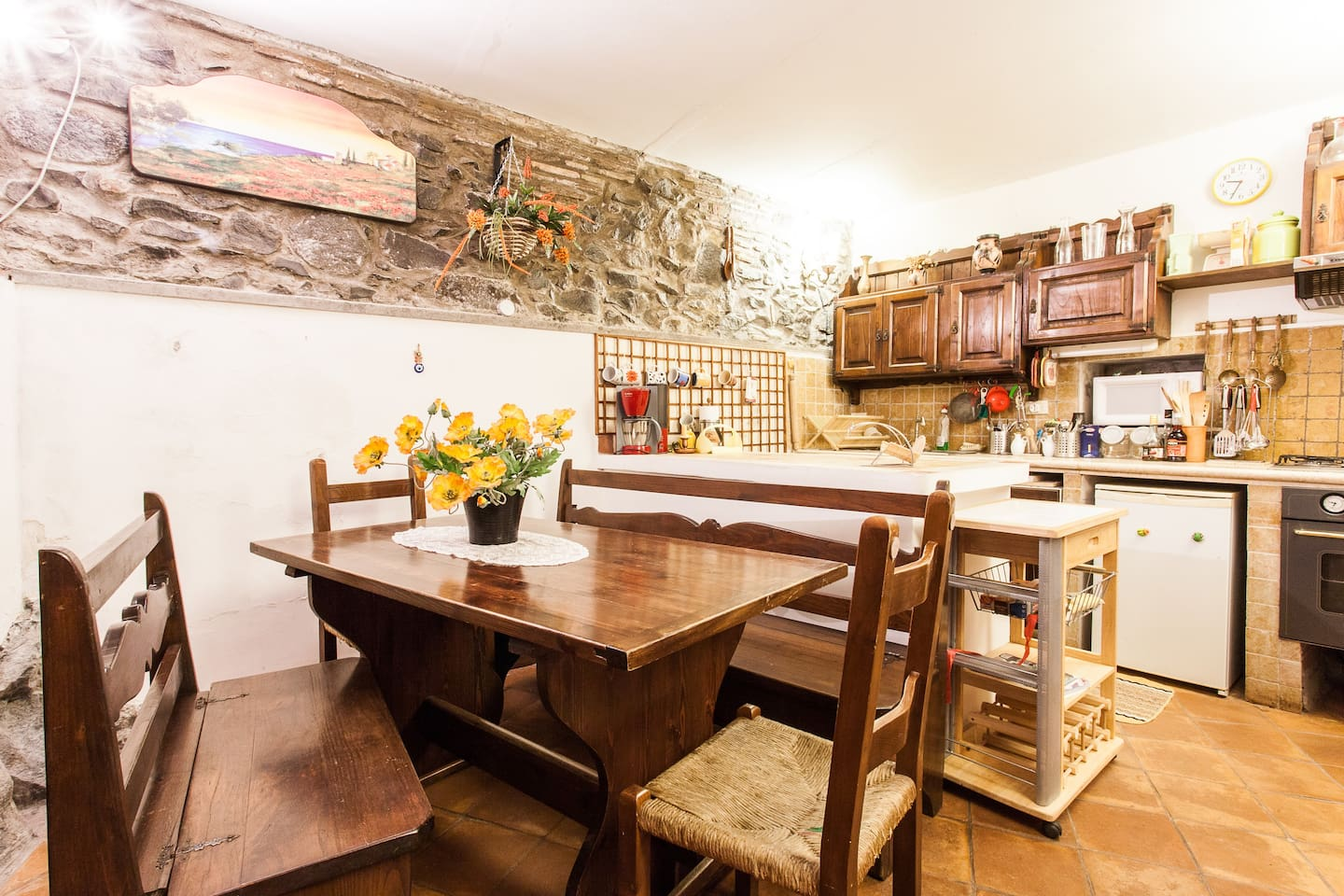 Tuscan style fully equipped rustic kitchen and dining area