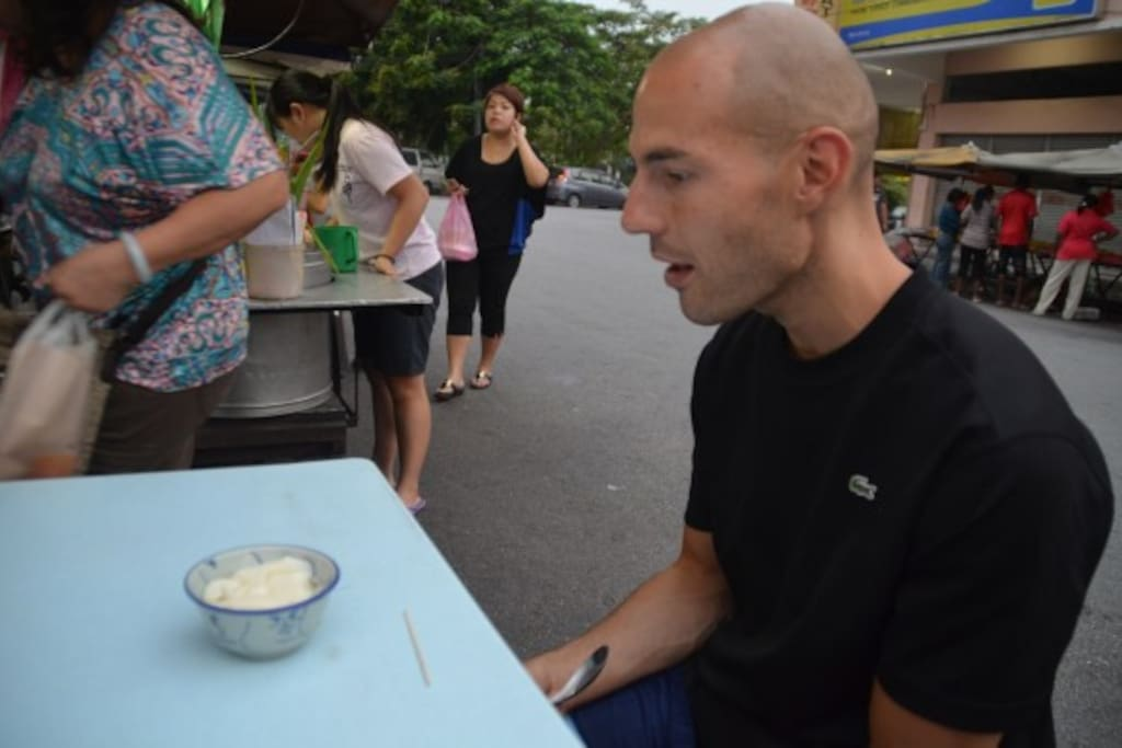 Justin Trying Local Soy Bean Curd