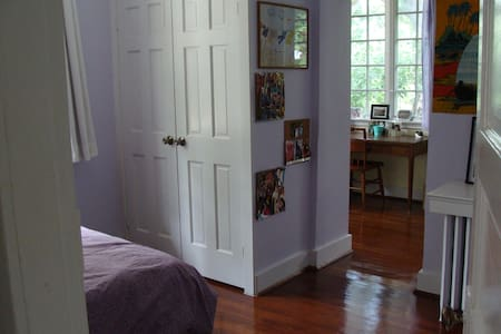 This sunny bedroom has an attached study with a desk, daybed and gorgeous french casement windows.  The bed is a super comfortable queen in a spacious room with wood floors, high ceilings, and lots of closet space.  The attached study has been converted from an old-fashioned sleeping porch so you can work inside but feel like you're outside in a treehouse!  Get a good night sleep and your work done in this suite-style bedroom.