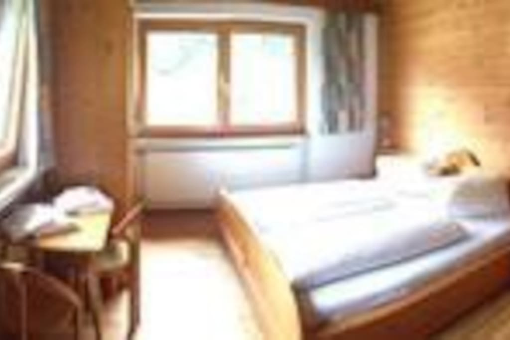 Bedroom for 2-3 persons with washbasin and mirror