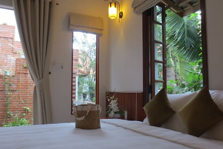 Welcome to our family! There're 5 charming rooms in our house, 1 room is for us and the other 4 rooms are for our guests who would like to experience the daily life of local charming people. Great location, comfortable rooms, truly local experience.