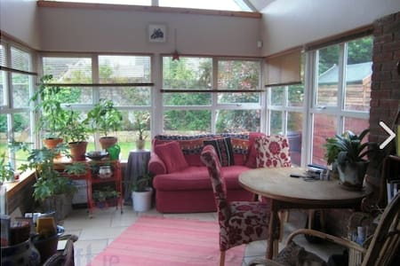 Double Bedroom in a cosy bungalow situated in a small quiet safe estate at the edge of historic Castlebridge. Shared bathroom, Large sitting room with stove. Kitchen, dining room and conservatory