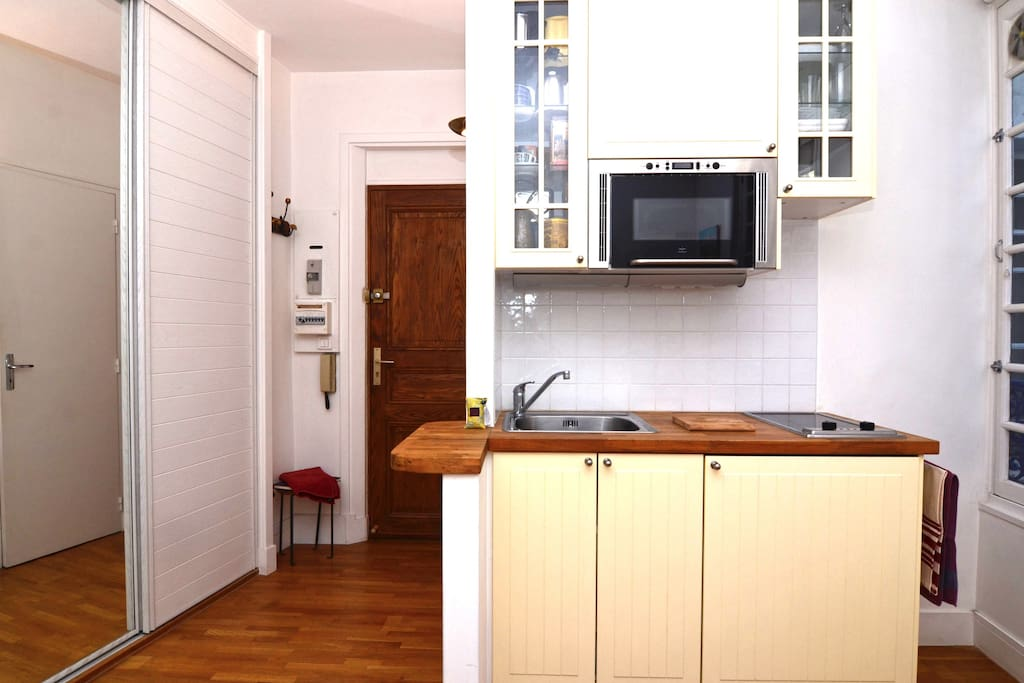 Well-equipped kitchen space and studio entrance