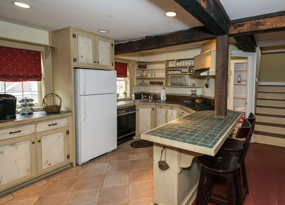 The cottage's spacious kitchen includes a full complement of appliances