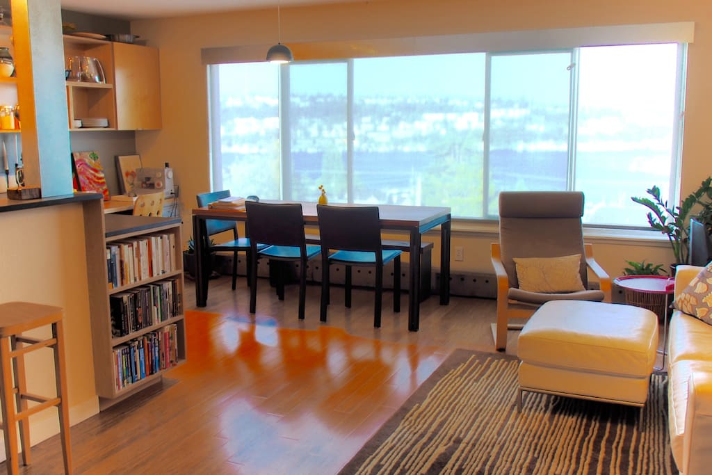 Comfortable Living and Dining room with incredible view of Lake Union