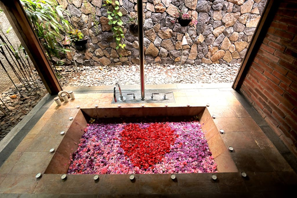 Surprise your loved one with a flower bath, in-villa massage or a romantic candle light dinner at Wahyu Villa