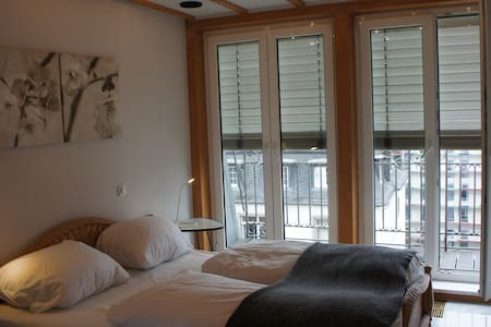 Room in Penthouse in Westend/Messe