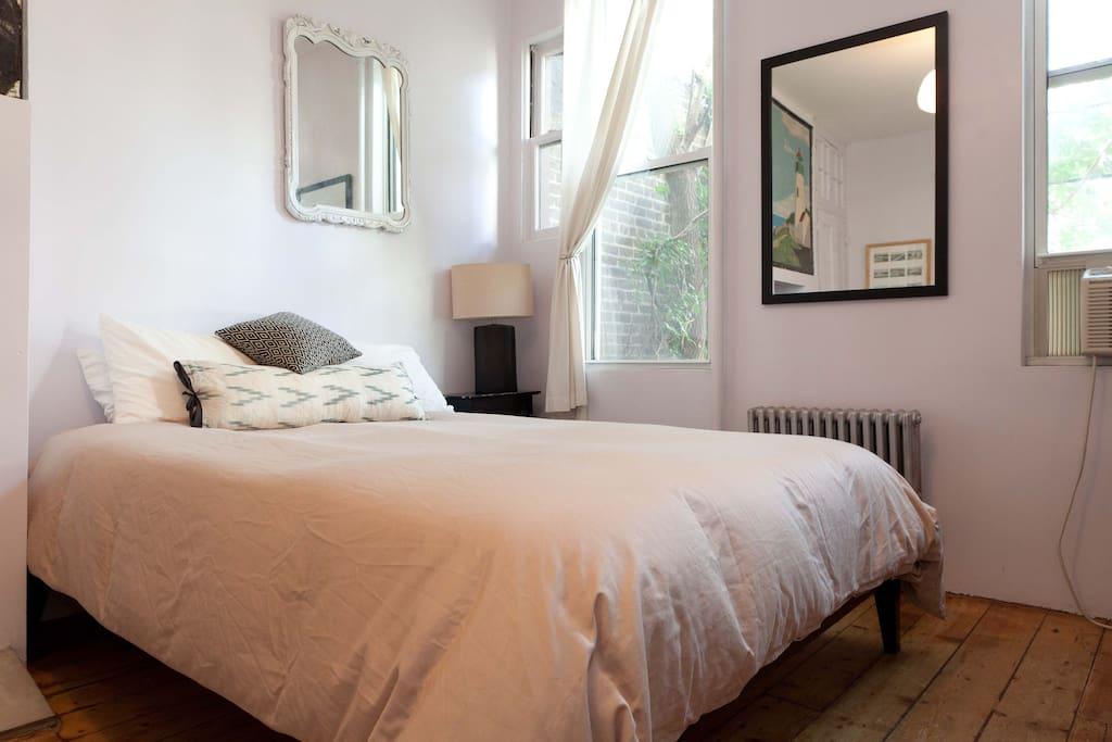 Comfy bed overlooking quiet backyards.