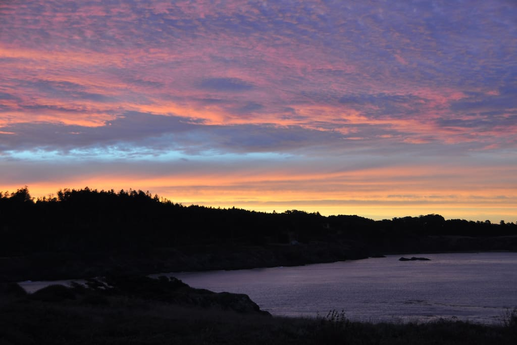 Wake to a sunrise view from the balcony. Big River meets Mendocino Bay.