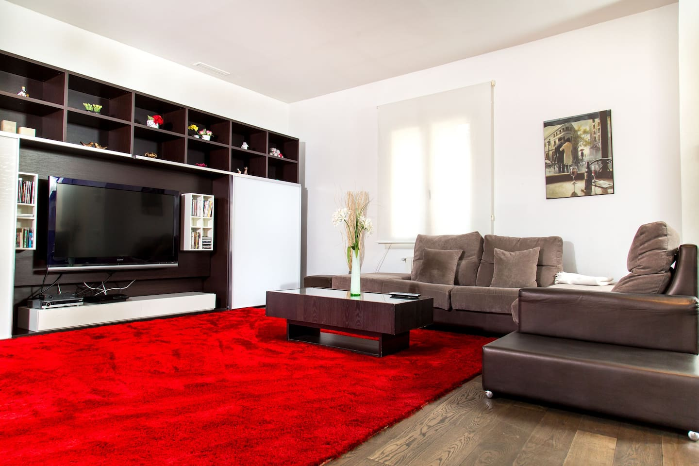 modern and spacious living with sofa, tv and ps 3