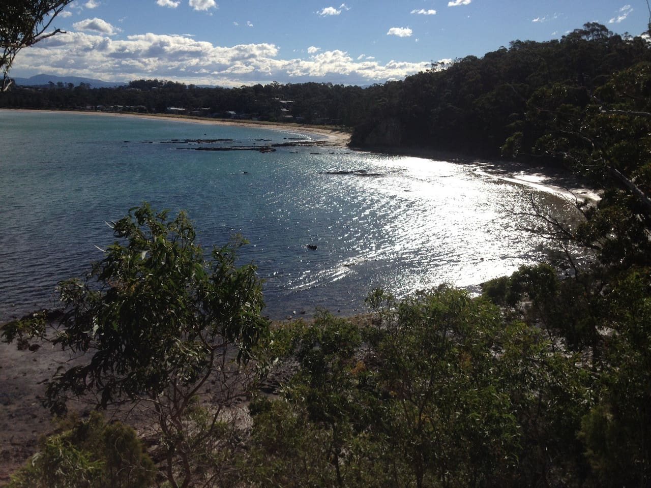 A fabulous view of the bay at any time of the day or year from the headland adjacent to the Moonrise Studio Apartment